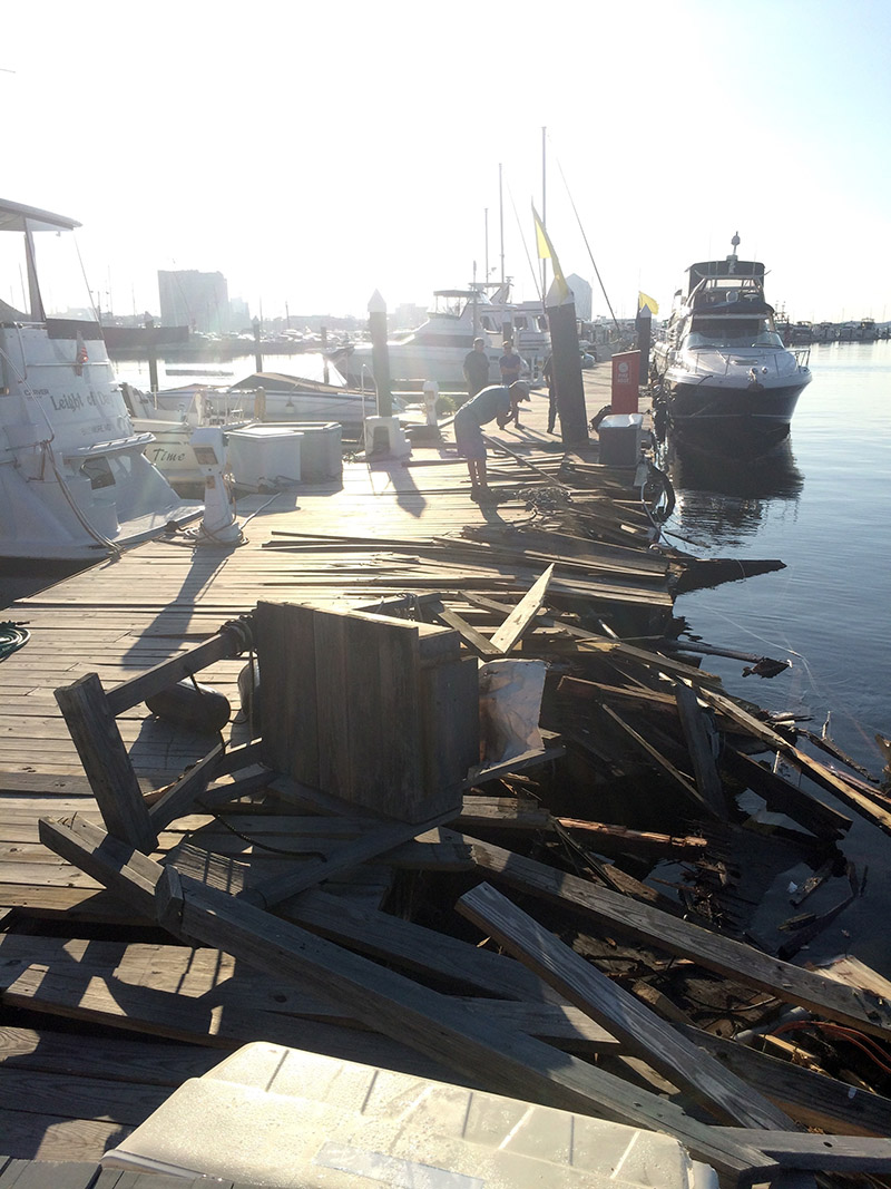 Damage to the pier at Henderson's Wharf Marina caused by the Spirit of Baltimore. USCG photo.