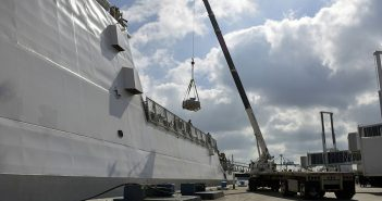 The Coast Guard Cutter Hamilton crew offloads approximately 26.5 tons of cocaine Dec. 15, 2016 at Port Everglades Cruiseport in Fort Lauderdale, Fla.