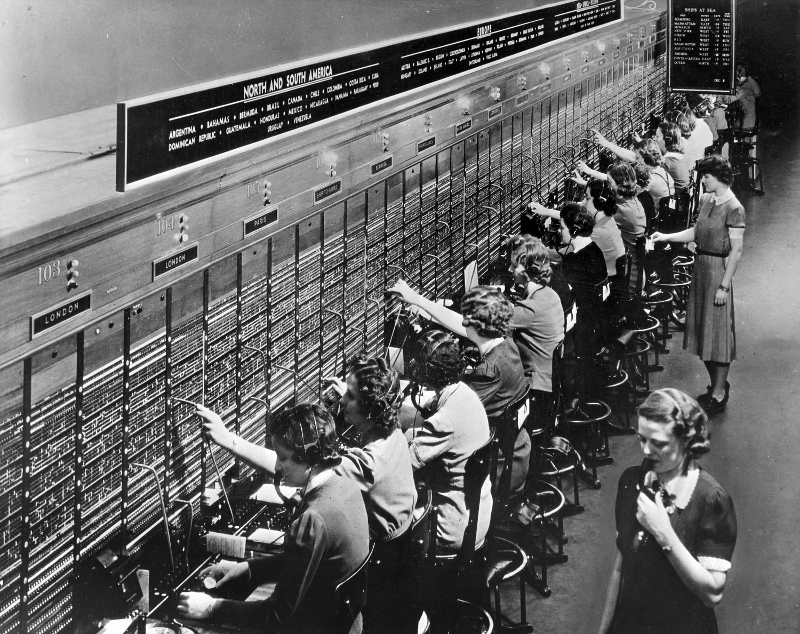 High seas and overseas radio operators at AT&T's New York City switchboard in 1943 handled calls through station WOO. AT&T photo.