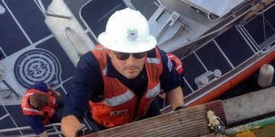 Chief warrant officer Aaron Studie boards a vessel during an inspection in the mid-Atlantic region. Coast Guard photo.