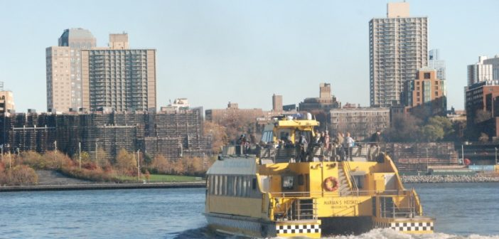 A New York Water Taxi ferry carries passengers to Brooklyn on the East River. Kirk Moore photo.