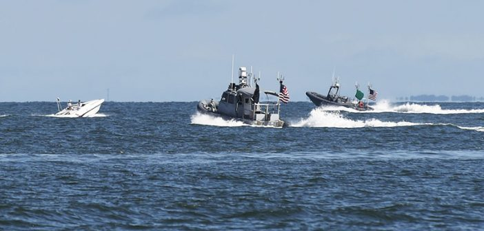Autonomous boats close in on a contact of interest during an Office of Naval Research-sponsored demonstration of swarmboat technology in Virginia Beach, Va., Sept. 30, 2016.