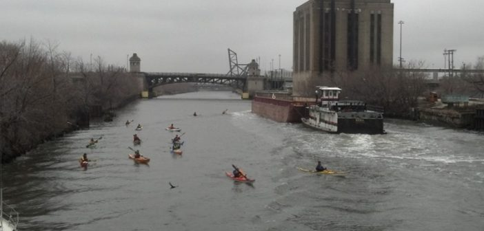 Kayakers and commercial traffic on the Chicago River. Creative Commons/ Larry Dostal via NTSB.