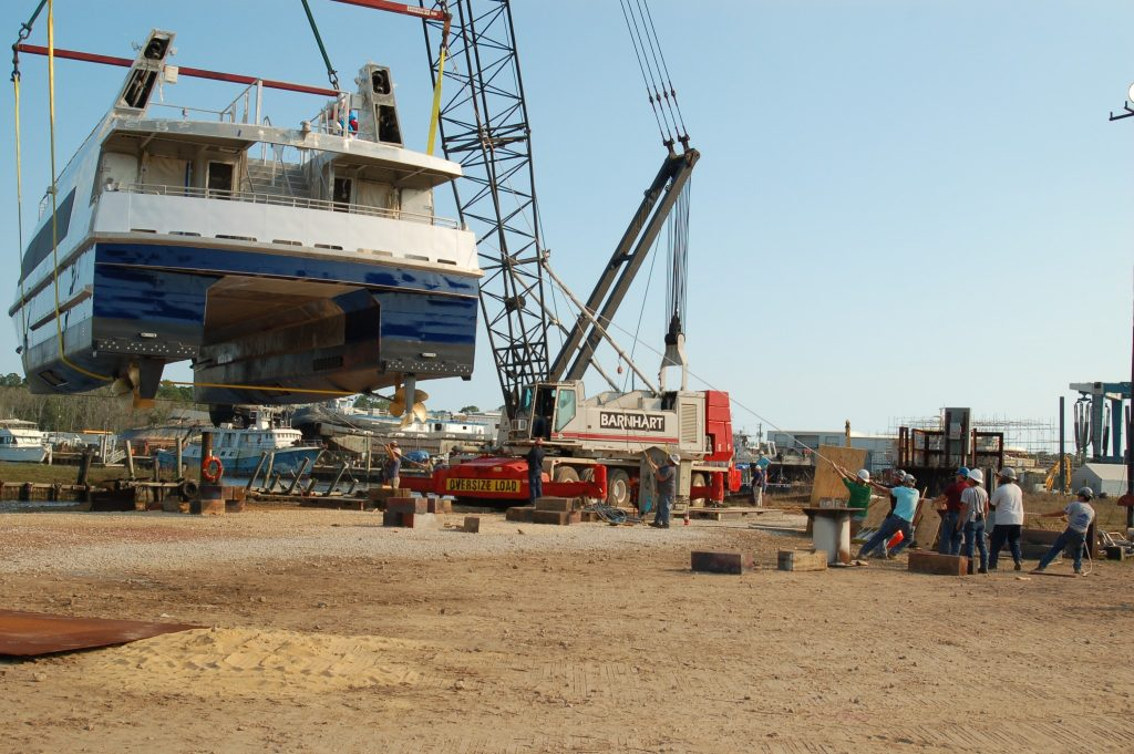 A crane operator and rigging crew move the ferry into position. Ken Hocke photo