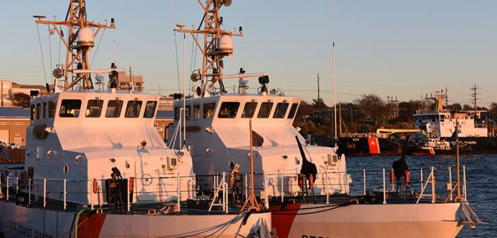 Coast Guard Cutters sit at the pier at Naval Station Newport in Rhode Island. USCG photo.