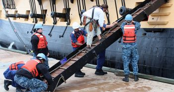 Sailors assist the crew of the French Tall Ship L'Hermione in securing their gangway, June 5, 2015 after the ship moored at the Riverwalk in Historic Yorktown, Va. Mark Piggott photo via USCG.
