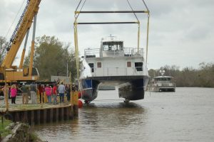 Props enter the water first as the ferry is lowered. Ken Hocke photo