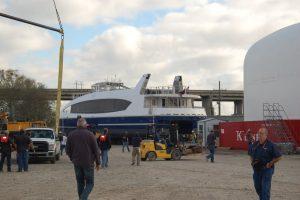 Transporter crew guides ferry in tight turn. Ken Hocke photo