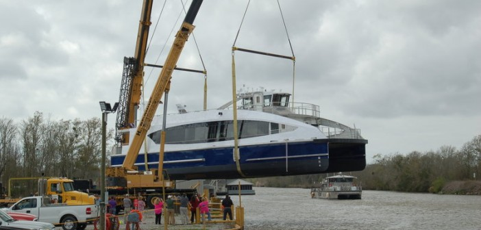 First new aluminum ferry for Citywide Ferry from Metal Shark travels to the water by air, assisted by two cranes. Ken Hocke photo.