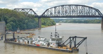 The U.S. Army Corps of Engineers dredge Bill Holman conducts Ohio River channel maintenance at the McAlpine Locks, Louisville, Ky., in 2013. USACE photo.