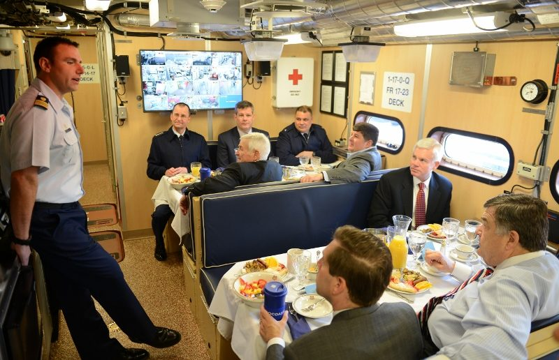Lt. Cmdr. Joe Rizzo, commander of the cutter cutter Lawrence Lawson, speaks to members of the House Appropriations Committee during breakfast aboard the  Lawson in Washington, D.C., Thursday, Mar. 9, 2017. USCG photo.