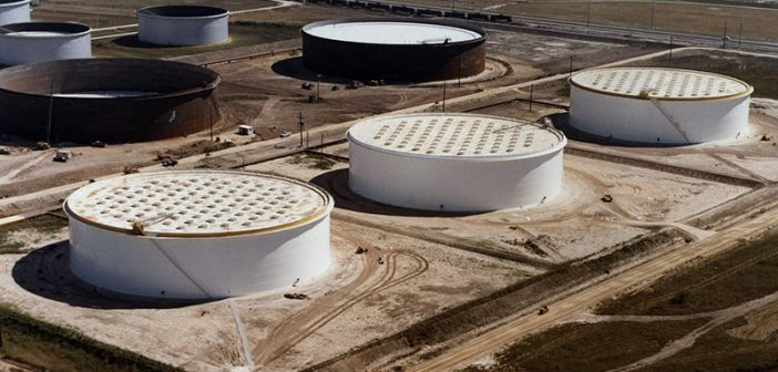 Aerial view of three (white) U.S. Department of Energy crude oil storage tanks in the foreground at the Sunoco Terminal near Nederland, Texas. DOE photo.