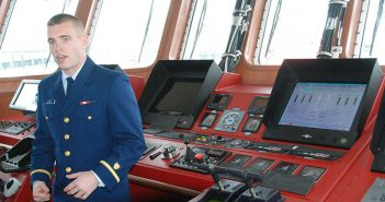 Ensign Lee Moore explains the layout and equipment to visitors on the bridge of the Lawrence Lawson. Kirk Moore photo.