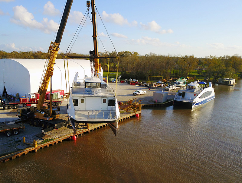 Metal Shark's second Citywide Ferry hull is lifted above the Charenton Canal. WorkBoat photo.