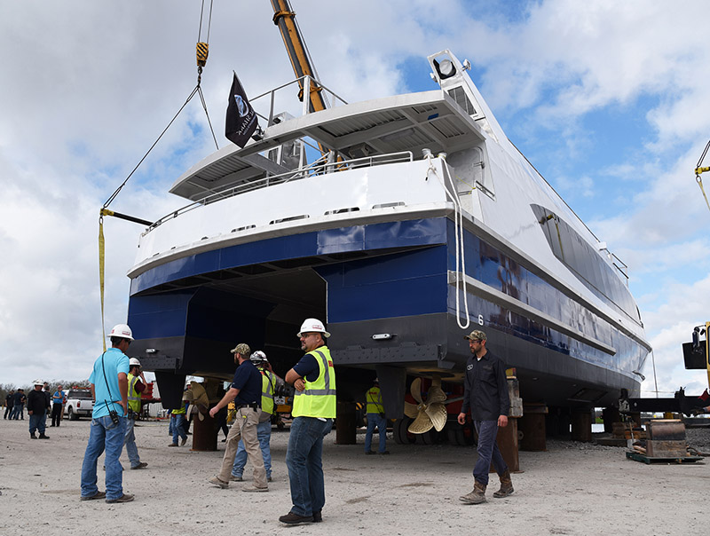 Assisted by a pair of cranes, the Metal Shark team prepares to lift the first ferry to the water. WorkBoat photo.