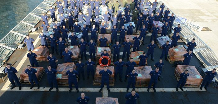 The Coast Guard Cutter James crew and a Helicopter Interdiction Tactical Squadron (HITRON) MH-65 Dolphin helicopter crew offload approximately 16 tons of cocaine Tuesday, March 28, 2017, in Port Everglades, Fla. USCG photo.