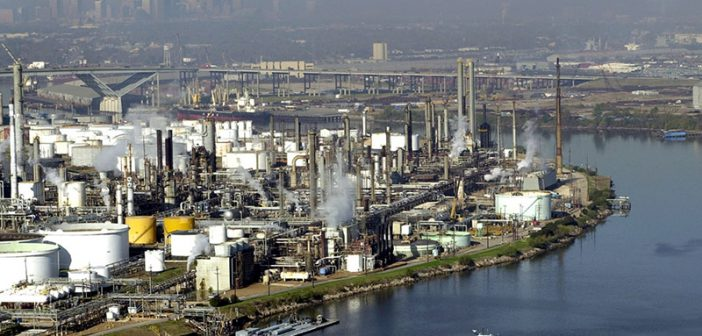 The Houston Ship Channel is dotted with oil refineries and petrochemical plants. USCG photo.
