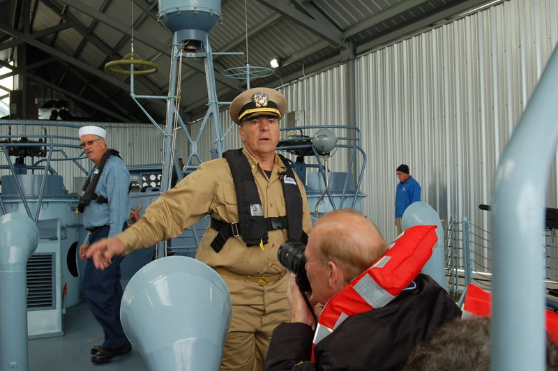 Capt. George Benedetto giving instructions to the crew before PT-305 left the boathouse. Ken Hocke photo