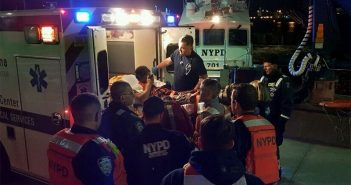 EMTs place a crewman into an ambulance after he was evacuated from the tugboat Mister T in New York on April 13, 2017. NYPD photo.