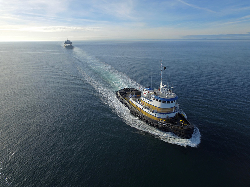 The Susitna under tow by Ernest Campbell en route to the Philippines. Harley Marine Services photo by Bart Pinder.