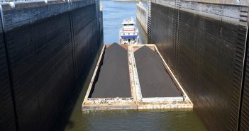 A towboat pushes coal barges through Old Hickory Lock on the Cumberland River. USACE photo by Lee Roberts.