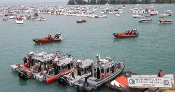 Law enforcement and emergency response vessels stand by to assist as needed during the annual unsanctioned Jobbie Nooner boating party at Gull Island in Lake St. Clair, Mich., June 26, 2015. The event typically draws thousands of boats and upwards of 50,000 people, and in 2015 required dozens of rescues, medical evacuations and law enforcement assistance. USCG photo by Chief Petty Officer Nick Gould.
