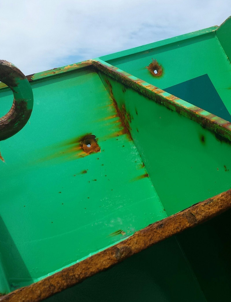 A close-up of bullet holes in Clay Head buoy number 7, found submerged off Rhode Island on April 24, 2017. USCG photo by by Chief Warrant Officer 3 Patrick Morkis.