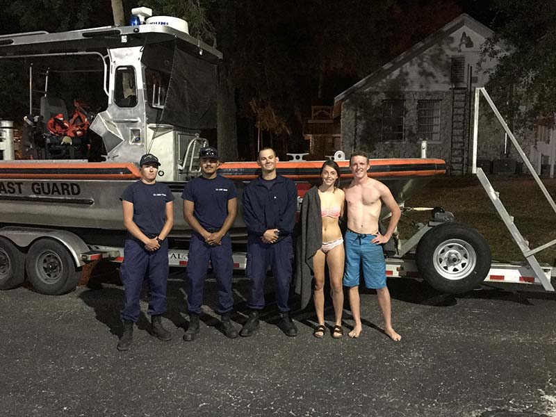 The plane crash survivors pose with Coast Guard crew members from Station Yankeetown in front of the 24' Special Purpose Craft-Shallow Water boat used in their rescue. USCG photo.