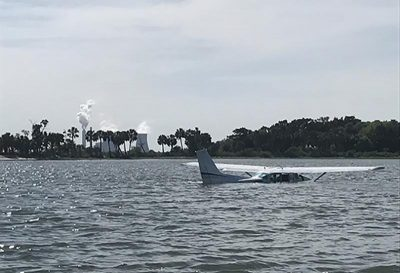 A single-engine plane sits in the water off Yankeetown, Fla., on April 20, 2017. Crew members from Coast Guard Station Yankeetown rescued two people from the plane after it crashed April 19. USCG photo by Petty Officer 1st Class Jason M. Andrade.