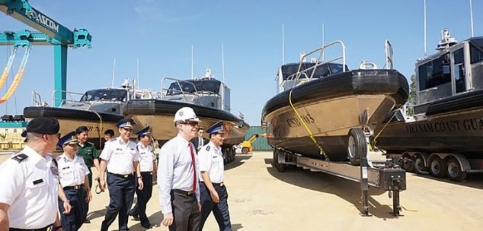 U.S. Ambassador Ted Osius, center, walks with Vietnam Coast Guard members as they inspect new Metal Shark patrol boats during a delivery ceremony on May 22, 2017, in Quang Nam, central Vietnam. U.S. Embassy Hanoi photo.