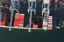 Aerial view of a containership being loaded. Creative Commons photo by Flickr user John Murphy.