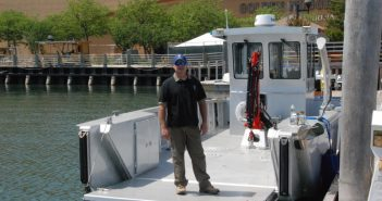 Captain Ken Hayek stands at the open bow ramp of the Robert C. Shinn Jr., a new water quality research vessel for the state of New Jersey. Kirk Moore photo.