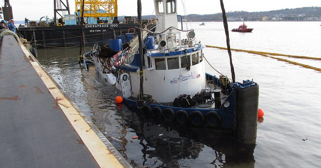 The tugboat Specialist raised by the Chesapeake 1000 crane after its March 12, 2016 sinking at the Tappan Zee Bridge. Coast Guard photo.
