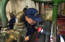 Ensign Patricia Carrow, a Coast Guard vessel inspector, examines a passenger vessel's systems during an annual inspection in Long Beach, Calif. on Dec. 7, 2016. Coast Guard photo/ PO3 Andrea Anderson.