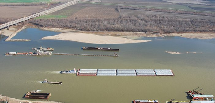 Barges transit the Mississippi River near St. Louis. USACE photo.