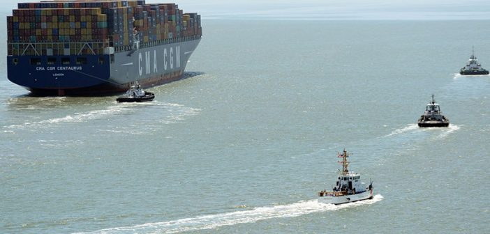 Tugs assist a containership in the San Francisco Bay. USCG photo.