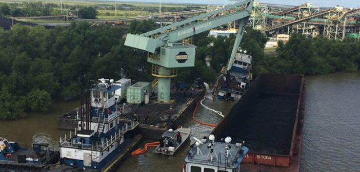 Towboat was taking on water Monday morning in the Mississippi River near New Orleans. USCG photo