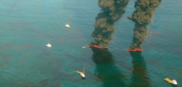 Oil from the Deepwater Horizon spill is burned in the Gulf of Mexico on May 19, 2010 as part of an effort to reduce the amount of oil in the water. USCG photo by Chief Petty Officer John Kepsimelis.