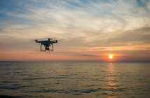 A drone over water at sunset. Creative Commons photo via Pexels.com.