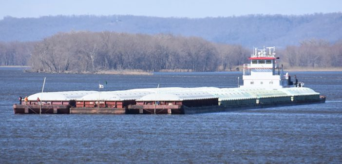 A towboat prepares to lock through Lock and Dam 10 on the Mississippi River in Guttenberg, Iowa. USACE photo by Patrick Moes.