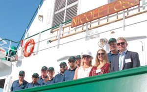 Nicole Engle (white hat) and family with the crew of the Nicole Foss. Foss Maritime photo.