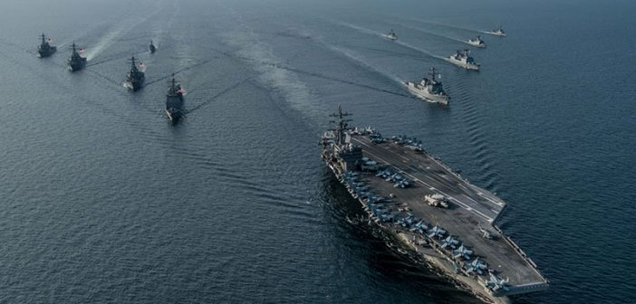 The U.S. Navy aircraft carrier Ronald Reagan steams in formation with ships from Carrier Strike Group Five and the Republic of Korea Navy during Exercise Invincible Spirit in October 2016. USN photo.