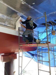 PPS ORCA vinyl film is applied to the tunnel of a NYC Ferry catamaran vessel. PPS Imaging photo.