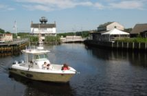 Captain Tom Masterson on the Fishful Thinking takes the first passengers out from Tuckerton Seaport on a water taxi run to Beach Haven, N.J. Kirk Moore photo.