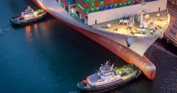 Tugboats assist a containership at the Port of Long Beach. Port of Long Beach photo.