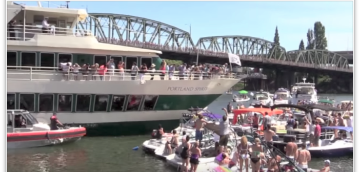 The tour boat Portland Spirit moves slowly through recreational boats on the Williamette River during the Portland Red Bull Flugtag event Aug. 1, 2015. YouTube/Kevin Harper image.