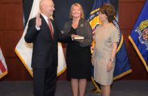 Rear Adm. Mark Buzby is sworn in to the top post at the Maritime Administration by U.S. Transportation Secretary Elaine Chao, right, as his wife Gina Buzby holds the Bible. U.S. DOT photo.