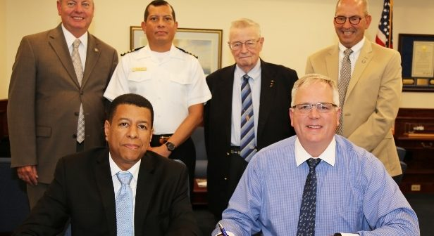 Representatives of SUNY Maritime and the International Maritime University of Panama have signed a cooperative agreement between the institutions. Front row, left to right: Capt. Aladar Rodriguez Diaz, president of International Maritime University of Panama, and Rear Adm. Michael Alfultis, president of SUNY Maritime College. Back row, left to right: Dr. Joseph Hoffman '75, interim provost and vice president of academic affairs at SUNY Maritime; Capt. Julio Bonilla, director of technical cooperation and international affairs office at International Maritime University of Panama; Capt. Charles Piersall '56, International Maritime Organization maritime ambassador; Capt. Mark Woolley, chief of staff at SUNY Maritime. SUNY Maritime photo.