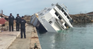 A Coast Guard marine safety team assesses a wrecked passenger vessel at St. Thomas. Coast Guard video still/PO2 Jonathan Lally