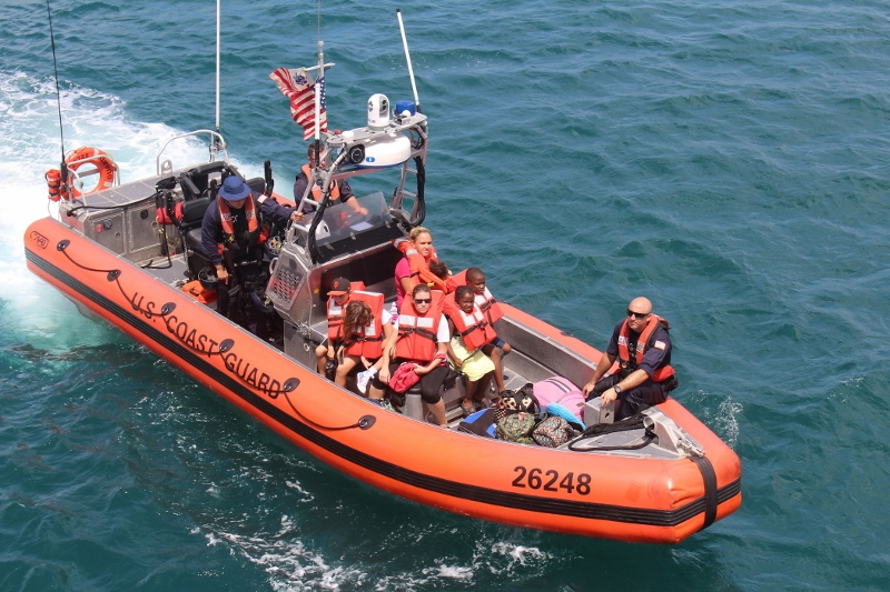 Evacuees from the U.S. Virgin Islands are brought to the Coast Guard cutter Valiant. Coast Guard photo